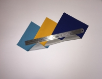 Fabric swatches of HyVent DT shell fabric in soft blue, gold and navy